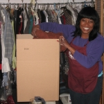 Gayle Chillious of Caring Transitions packs clothing for a client.
